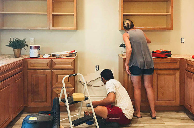 A couple working on their DIY home improvement project thanks to their rehabilitation mortgage loan