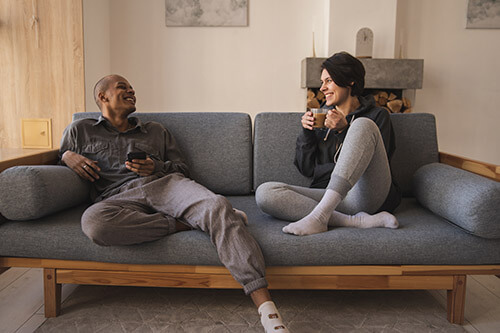 couple discusses credit score requirements on couch
