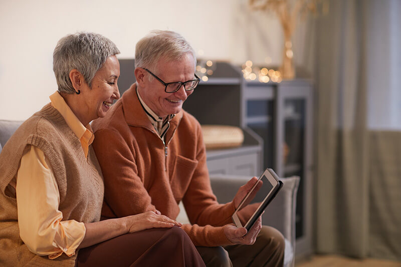 Senior couple browsing home financing options for their home renovation